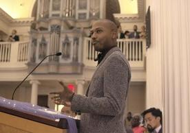 Student JaQuan Beachem reading during Advent Service